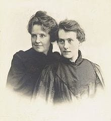 Two women posing intimately