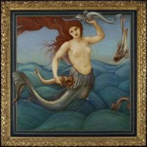The almost square oil painting is enclosed within a gold ornate frame. The image shows an open sea, with a silver-tailed mermaid holding a fish in each hand floating on turquoise waves, her long red hair blowing out behind her.