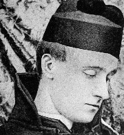 A black and white facial photographic portrait of Baron Corvo, turned to the left with side profile shown. Hat appears on top of head.