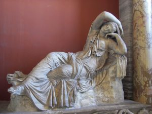 A pale sculpture of a reclined woman, Ariadne, who is seemingly halfway between sleeping and awaking.