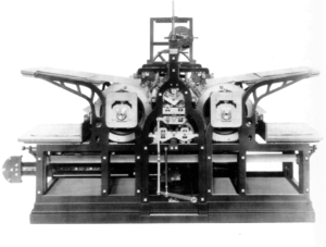 A black-and-white photograph of a steam printing press
